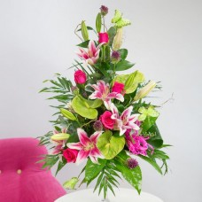 Flowers in Lanarkshire Roses and fragrant lilies are paired with exotic lime green anthuriums